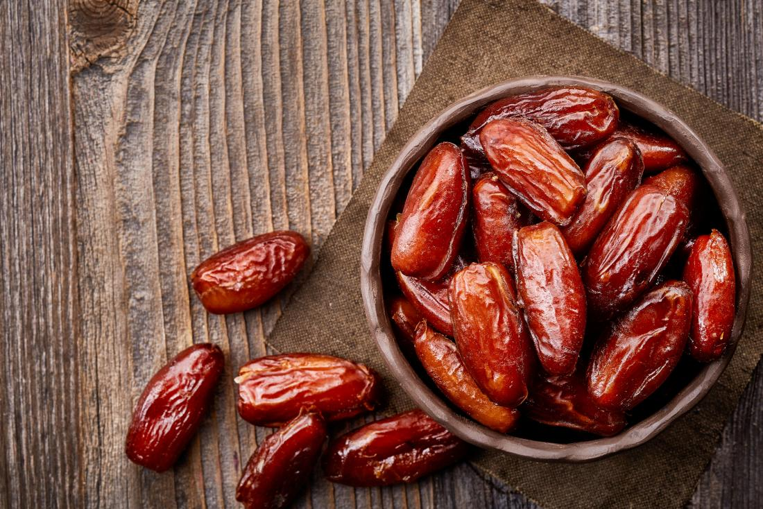 Dry dates in a bowl. Dates! top winter fruits